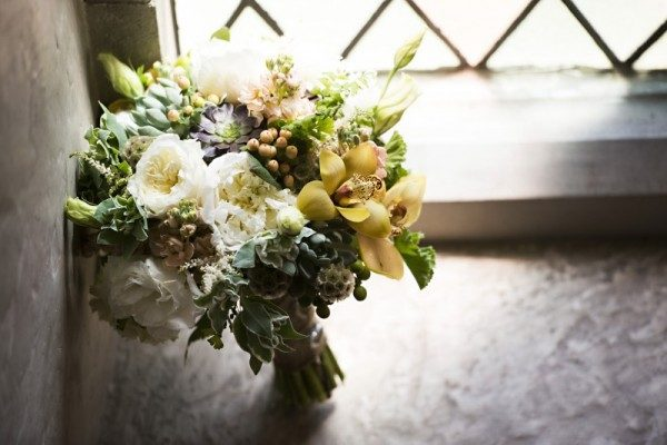 Twigs & Posies Colorado Springs florist wedding flowers cymbidium orchids, garden roses, succulents, scabiosa pods, hypericum berries